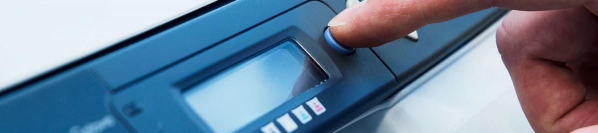 close-up of a hand pushing buttons on a printer, multifunction printer, managed print concept