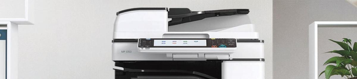 image of the top portion of a copier/multifunction device in and office setting