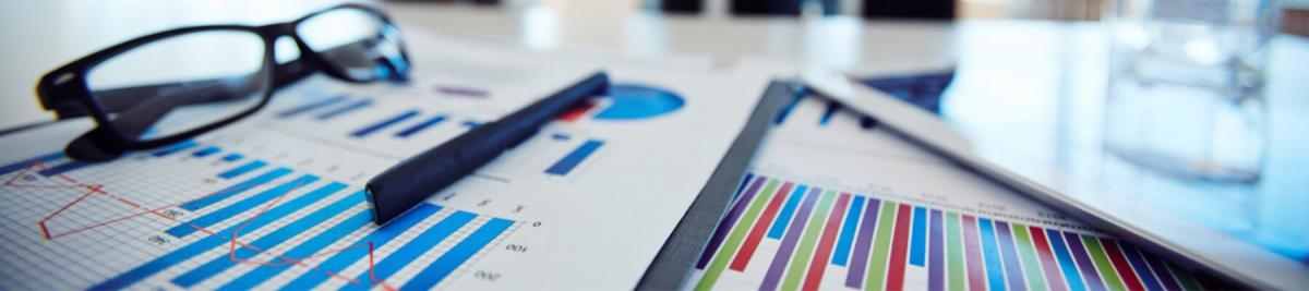 close up concept of graphs, facts and figures, saving money, business, managed print services